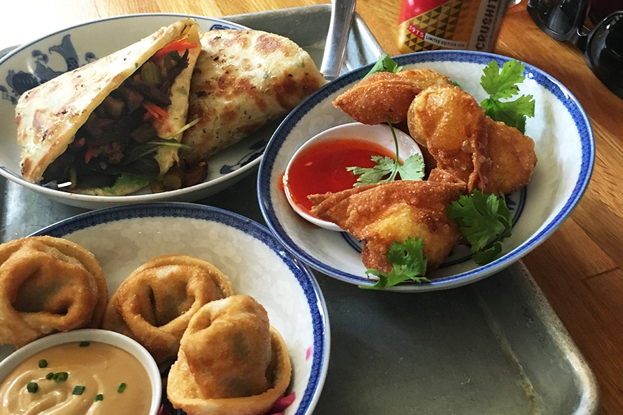 Lemongrass pork dumplings, the Pork Rossi scallion pancake sandwich, and complimentary crab Rangoons at Mei Mei