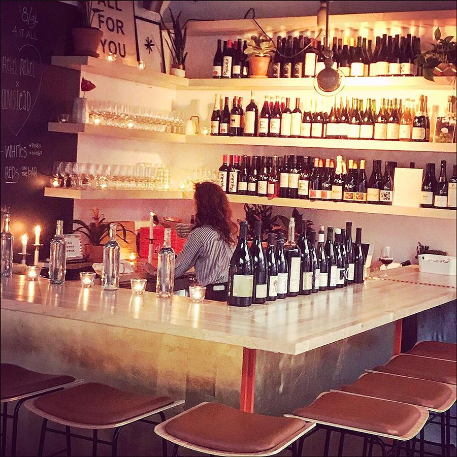 Lauren Friel behind the bar at Rebel Rebel Wine Bar