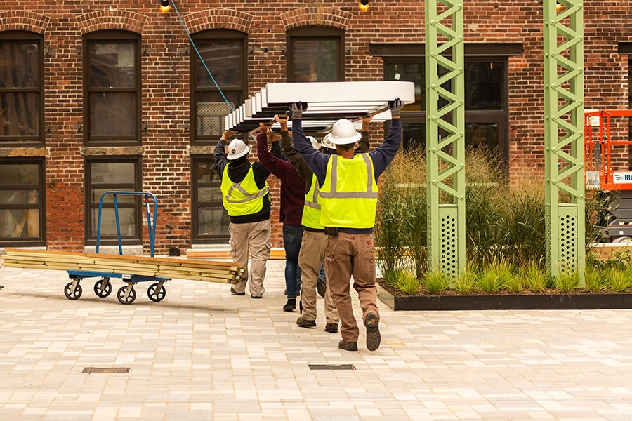 Contractors install the sign at the soon-to-open Trillium restaurant in Fort Point