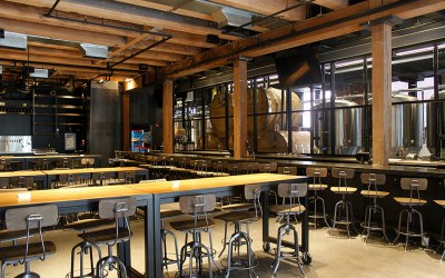 The Trillium Fort Point taproom overlooks the active brewery and retail area.