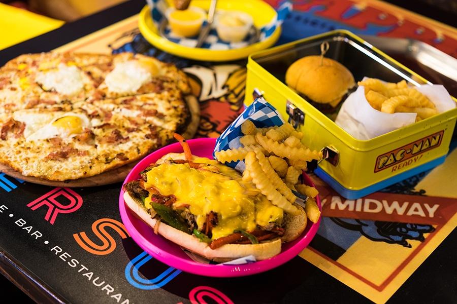 a spread of food at Versus Restaurant, Arcade, Bar menu Boston