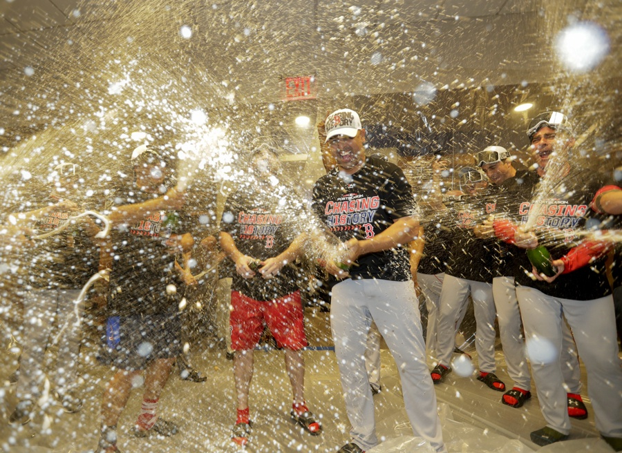 the boston red sox celebrate in the locker room after beating the new york yankees 4 3 in game 4 of baseballs american league division series tuesday