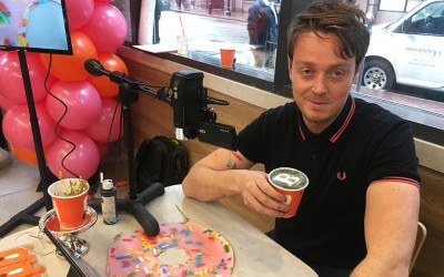 "Michael Breach—aka @BaristArt—created the Boston magazine ""B"" on a Dunkin' latte."