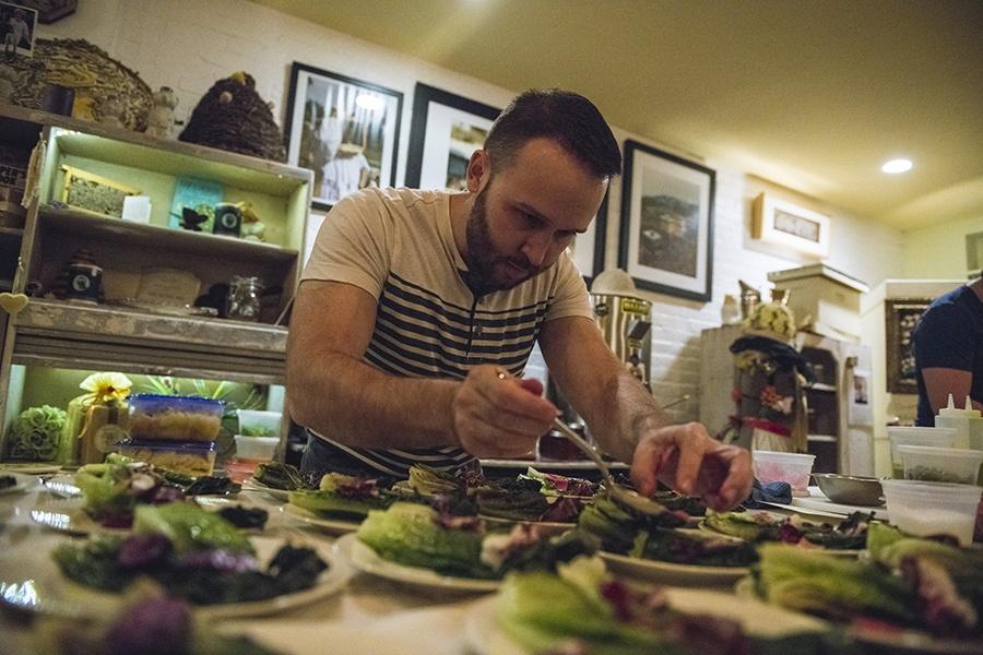 Chef David Yusefzadeh plates dishes at a past Sacrilicious cannabis dinner