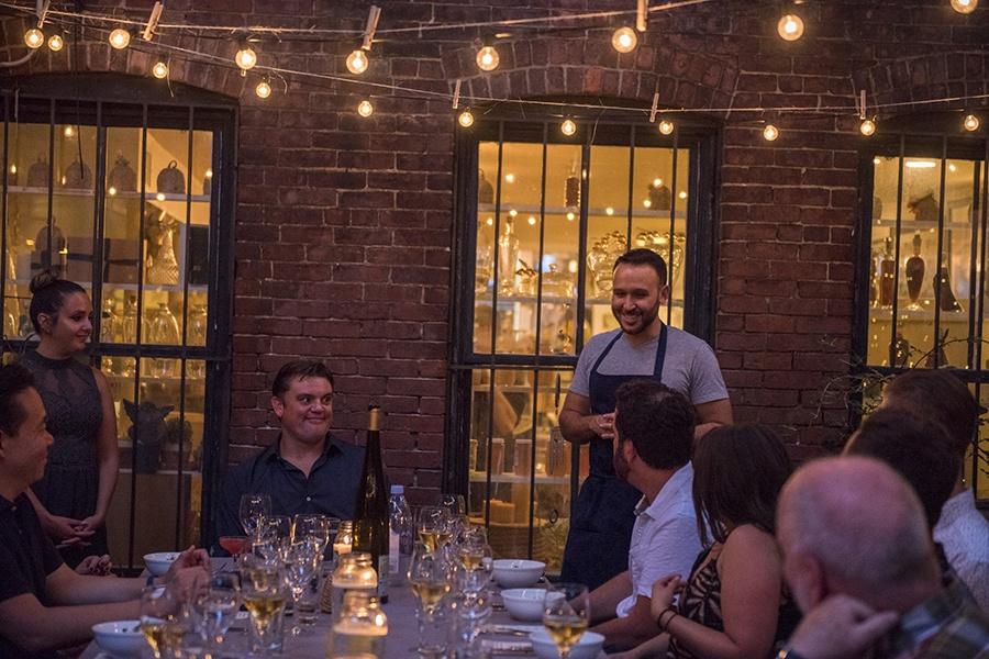 Sacrilicious cofounders Samantha Kanter, Sean Curley, and David Yusefzadeh greet guests at a past Sacrilicious cannabis dinner