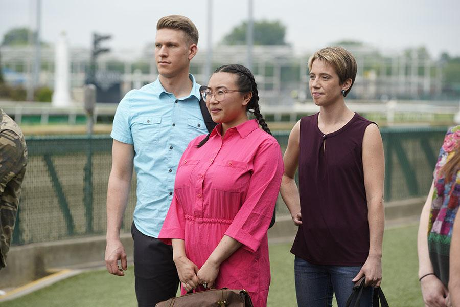 Adrienne Wright (right) stands with fellow contestants Nini Nguyen and Brandon Rosen to listen to instructions during the first episode of <em>Top Chef<em> Season 16