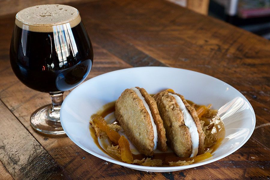 """Winter Hill Brewing coconut milk stout """"Praxis,"""" paired with an oatmeal cookie sandwich by Littleburg"""