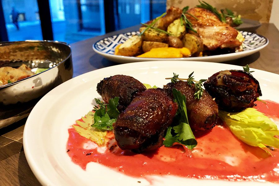 Bacon-wrapped dates with bleu cheese and orange glaze from the Bar Mercato dinner menu.