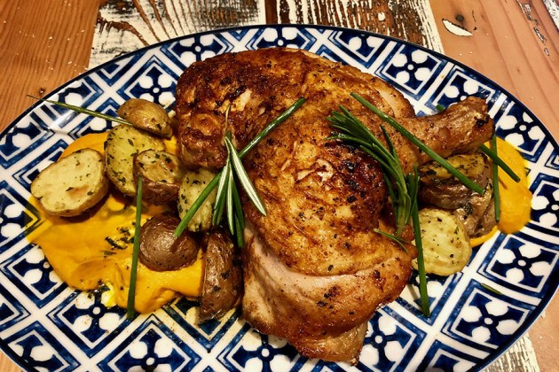 Brick chicken with herb-roasted fingerling potatoes from the Bar Mercato menu