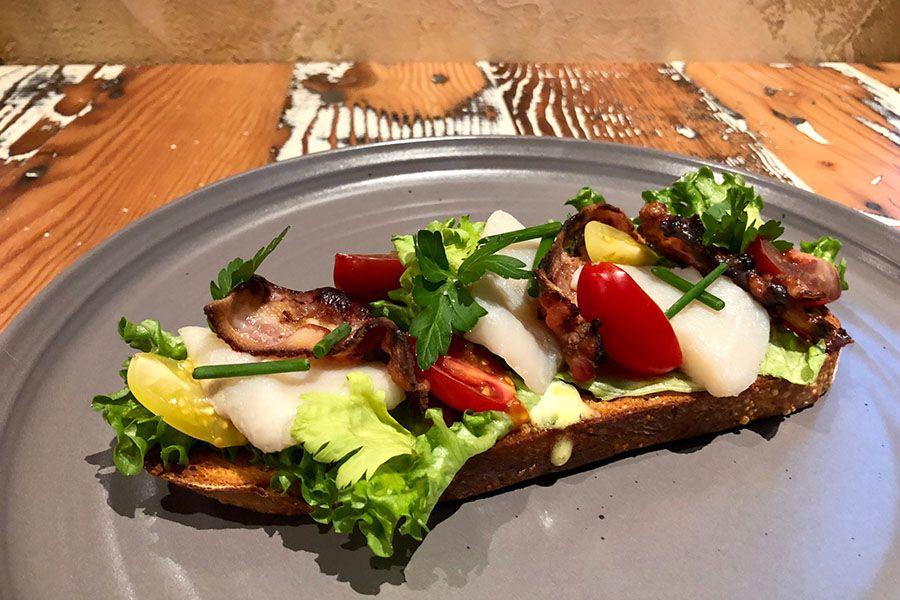 Pickled herring BLT on sourdough from the Bar Mercato dinner menu.