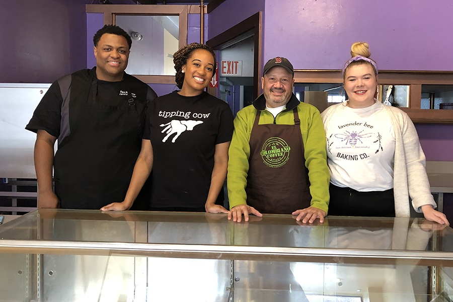 (L to R) Tipping Cow co-owners David Lindsey and Gerly Adrien, El Colombiano Coffee owner Javier Amador-Peña, and Lavender Bee baker Kelsey Munger inside their new store