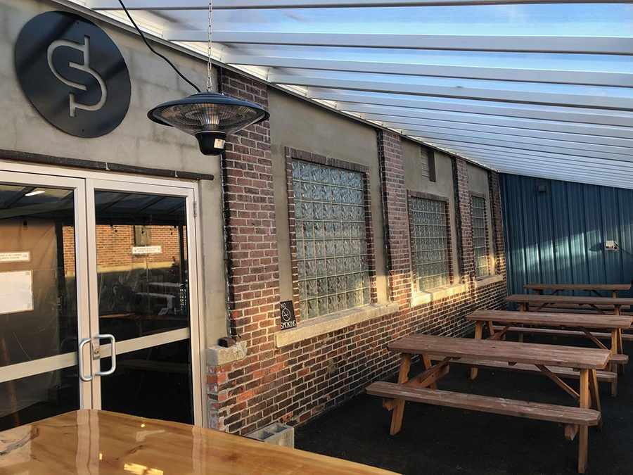 The outdoor patio at Short Path Distillery is now year-round, and home to a second bar