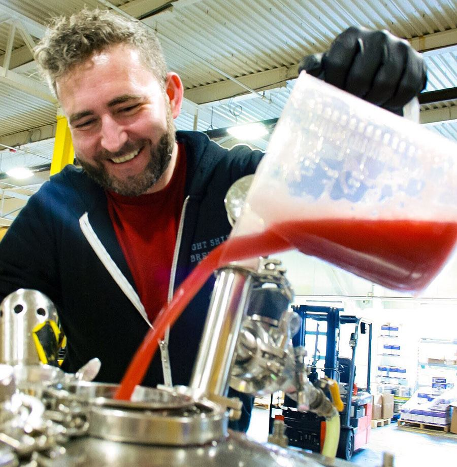 Beat Brew Hall manager Casey Furtaw adds beets to the collaboration beer he made with Springdale