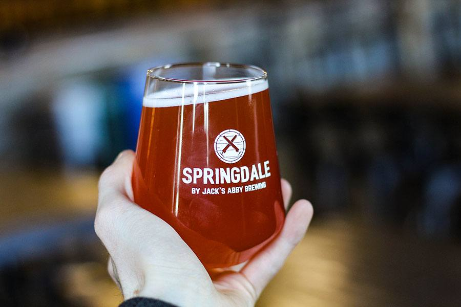a glass of Casey's Beet Beer by Springdale