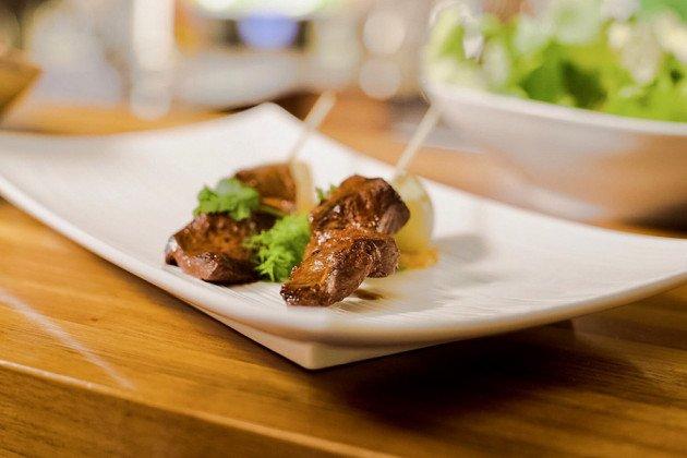 Anticucho de Corazón, (marinated beef heart skewers)