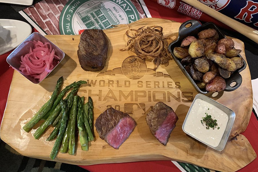 Fans with access to Fenway Park's exclusive Dell/EMC Club can dine on Savenor's steaks.
