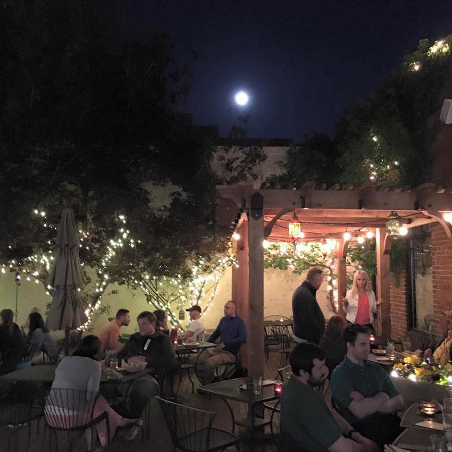 Sophia's Grotto patio at night