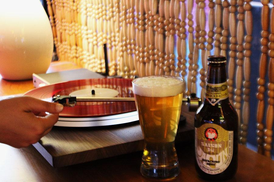 a record on a turntable with Hitachino Saison at the Groove at Hojoko