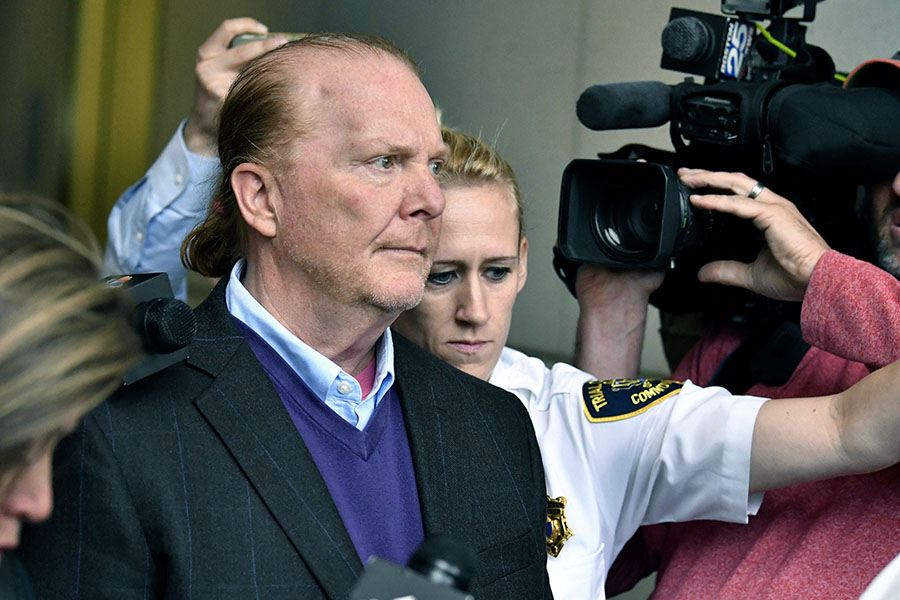 Chef Mario Batali departs after pleading not guilty, Friday, May 24, 2019, at municipal court in Boston, to an allegation that he forcibly kissed and groped a woman at a Boston restaurant in 2017