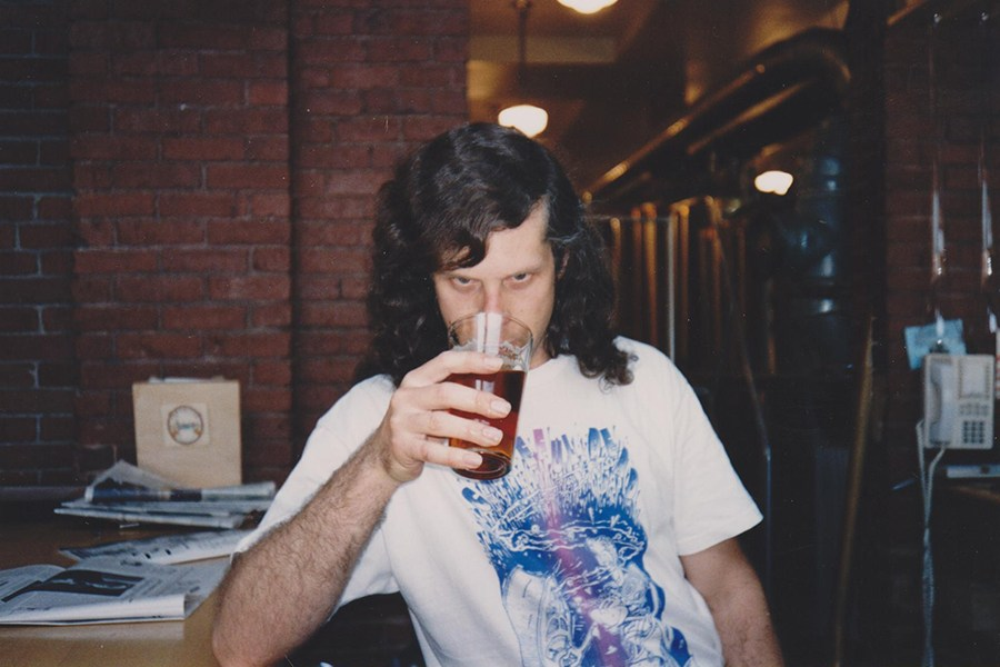Original CBC brewmaster Darryl Goss sips the fruits of his labor, circa early-1990s
