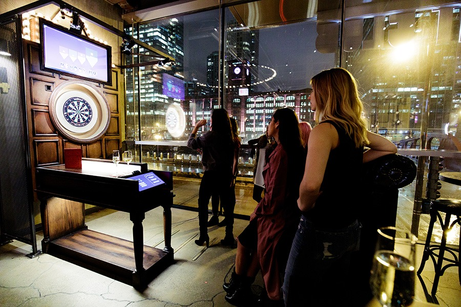 "Scenes from Flight Club in Chicago. The international ""social darts"" venue is coming to Boston in 2019"