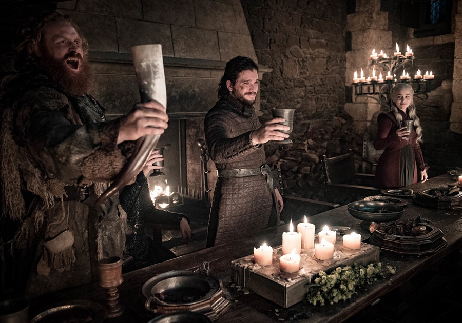 Game of Thrones toast: Kristofer Hivju, Kit Harington, Emilia Clarke. (Credit for all: Helen Sloan/HBO)