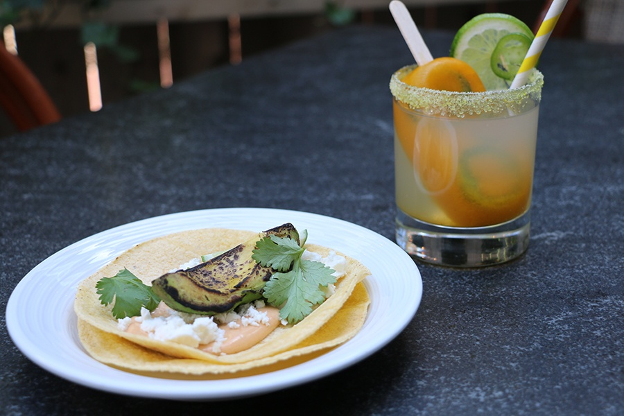 A spicy mango jalapeno margarita and a grilled avocado taco from the Poptails menu at Harvest.