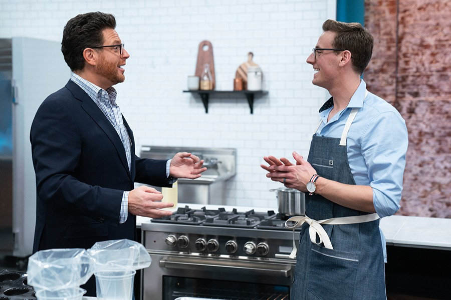 Best Baker in America host Scott Conant and contestant Joshua Livsey during a skills challenge, as seen on Best Baker in America, Season 3