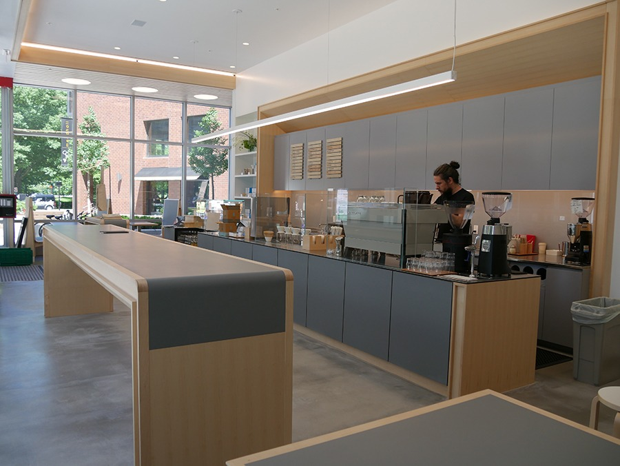 A barista at Blue Bottle Coffee gets ready to open the Kendall Square cafe