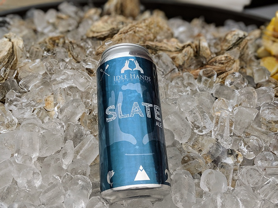 Idle Hands Slate can in ice with oysters
