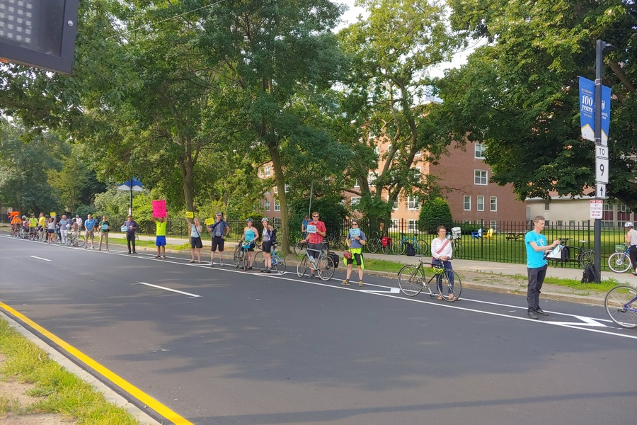 people-protected bike lane boston