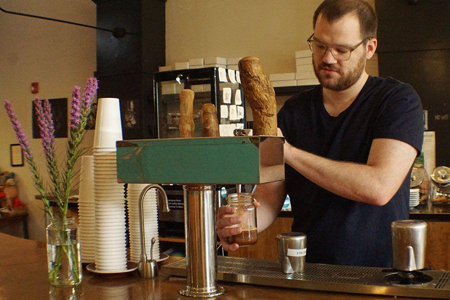 Barista Garrett Haddock pulls cold brew at Barismo 364