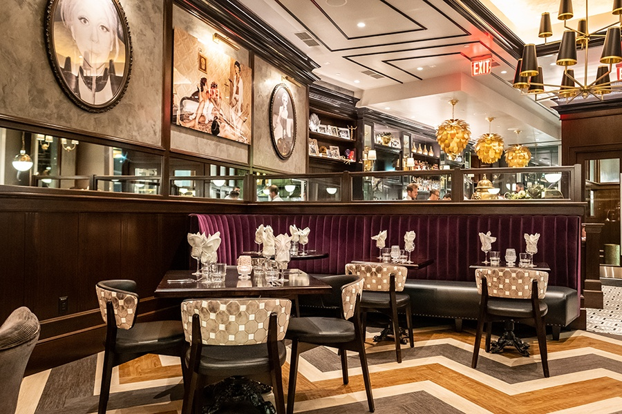 The dining room at Orfano features cheeky portraits of famous women