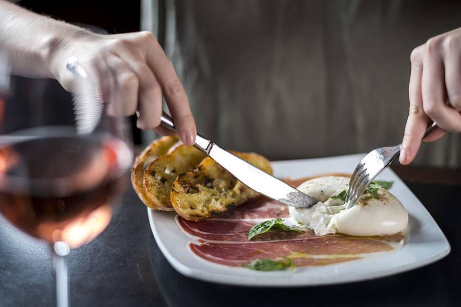 Creamy burrata and prosciutto at dbar