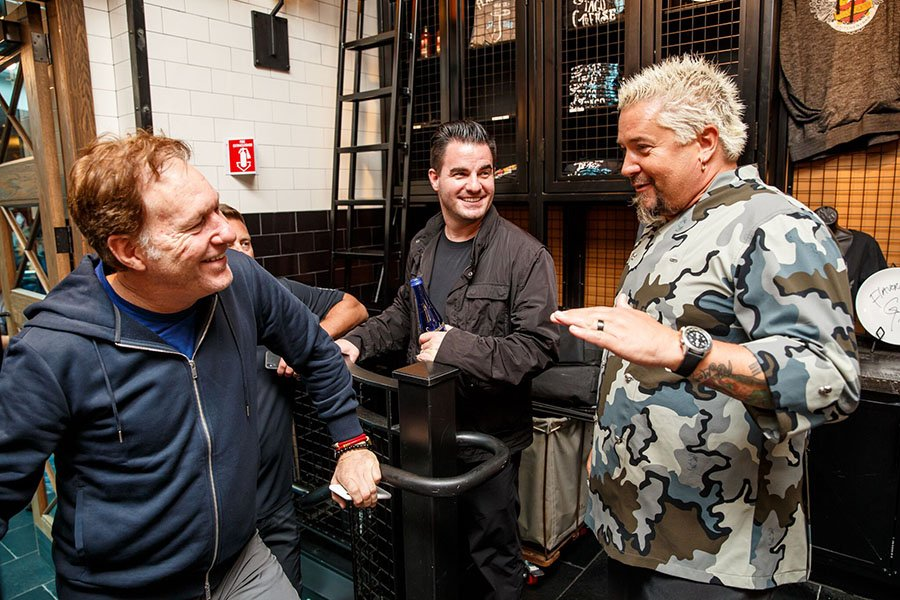 (L to R) Big Night Entertainment Group principal partners Ed Kane and Randy Greenstein meet with Food Network star Guy Fieri in Boston