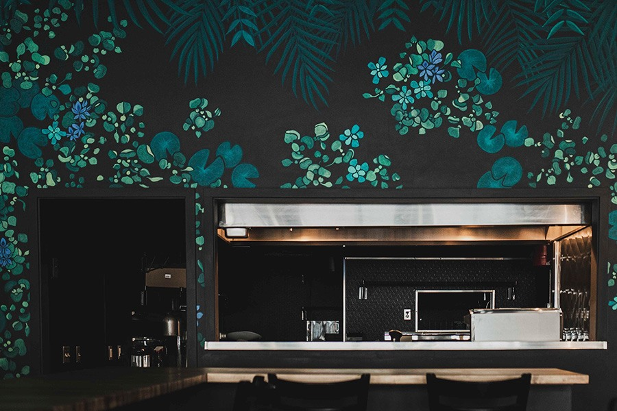 Chef's counter seats provide a front-row look into the kitchen at Nightshade Noodle Bar.