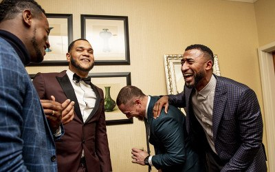 Eduardo Nunez #36, Eduardo Rodriguez #57, and Christian Vazquez #7 of the Boston Red Sox laugh with pitcher Luis Severino #50 of the New York Yankees during the 2018 Pedro Martinez Foundation Gala