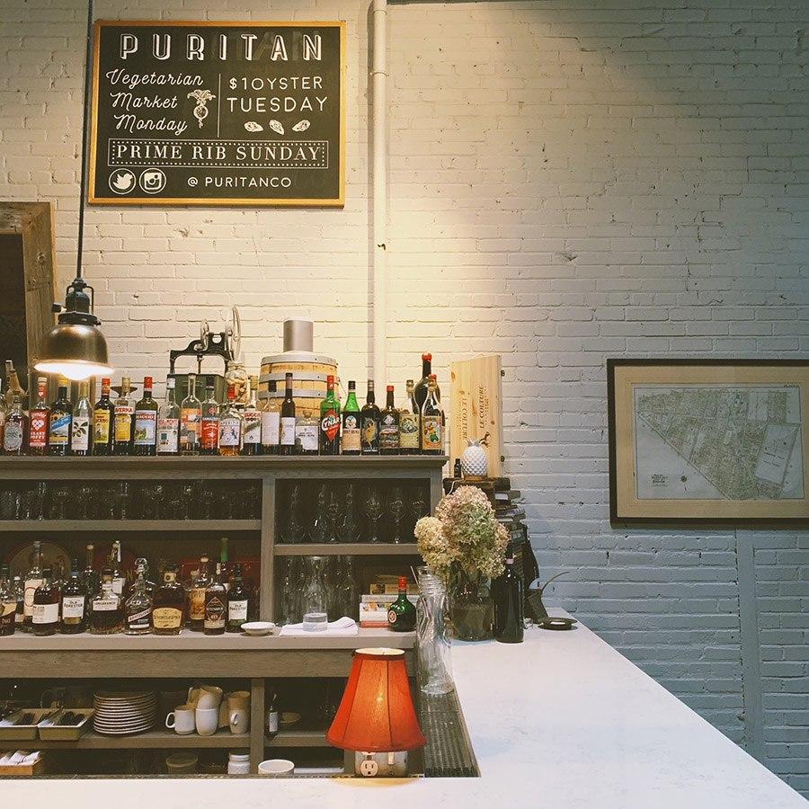 Grab a seat at the bar at Puritan & Co.