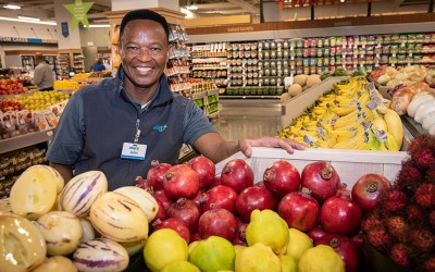A produce department employee at Star Market at the Hub on Causeway
