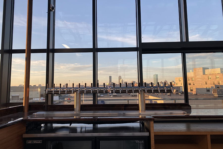 The rooftop beer hall at Dorchester Brewing Company boasts beautiful Boston skyline views