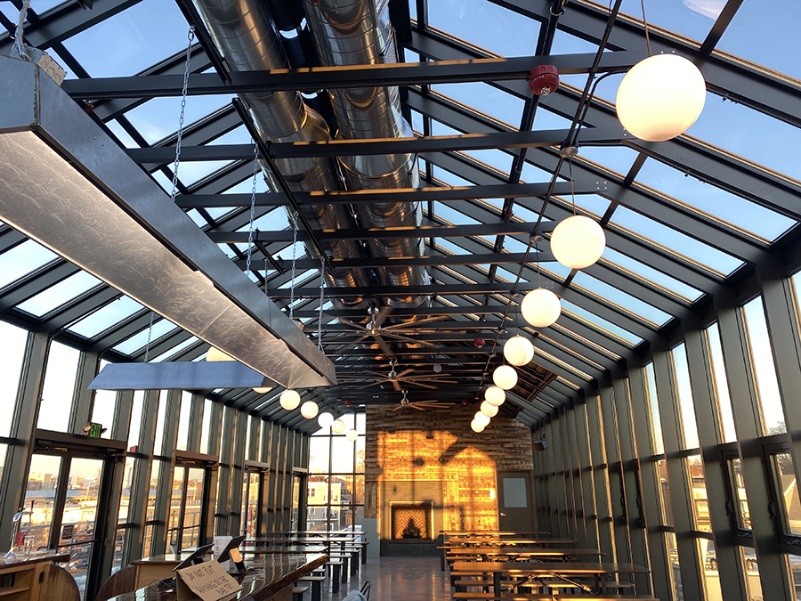 Glass-walled rooftop beer hall at Dorchester Brewing Company