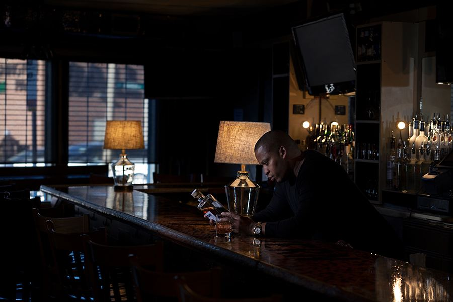 Royal C. Smith at his Roxbury bar, District 7 Tavern. Smith is part of a new Boston Black Hospitality Coalition, which aims to support and preserve the threatened community of black-owned bars in Boston. / Max Nagel Photography