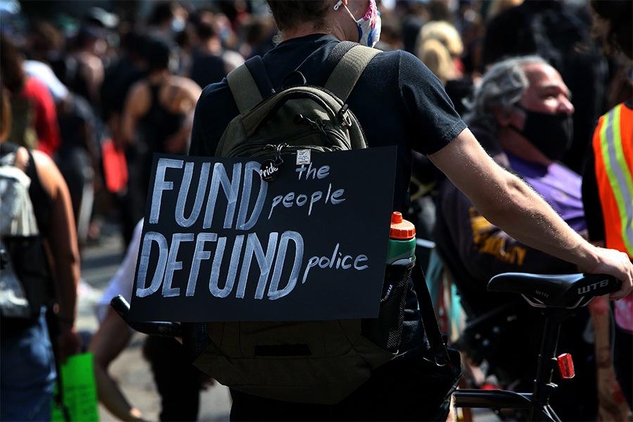 defund police sign boston protest