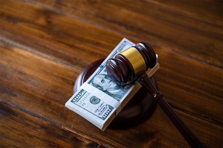 gavel and pile of money